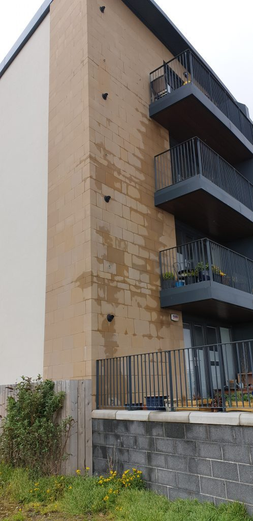 The tenement requires a common repair to prevent excess water on the sandstone cladding.