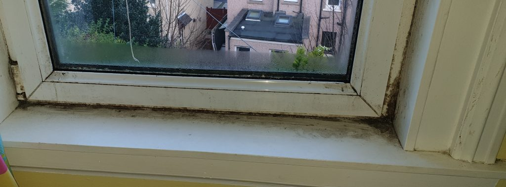 Mould and condensation on a UPVC double glazed window